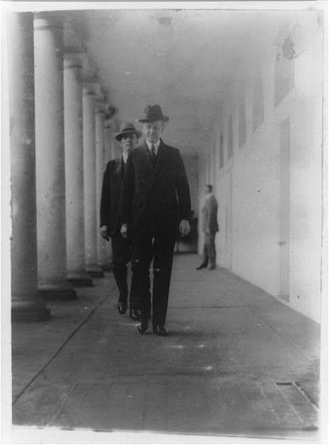 President Coolidge heading home to the Executive Mansion from the West Wing down the West Colonnade, December 30th, 1925 (Library of Congress)
